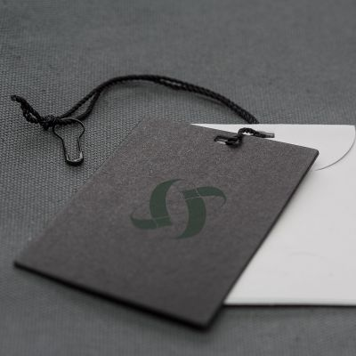 Cardboard double hang tag with rope and brooch