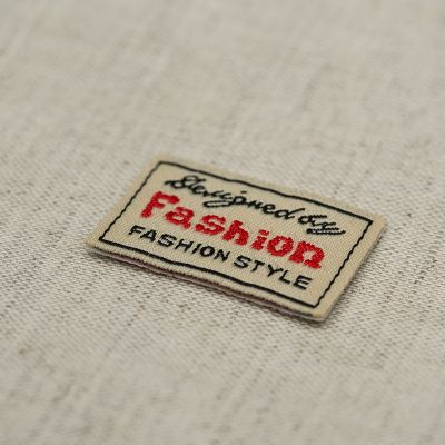Embroidered cotton label with reinforcement back