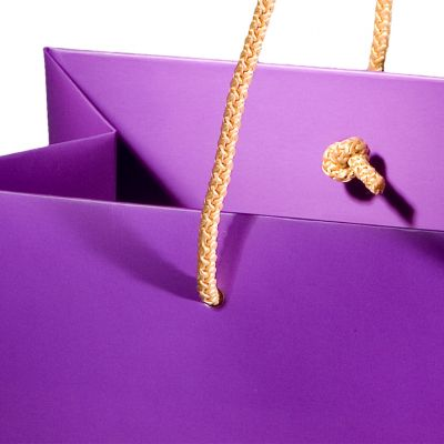 Carrier paper bag with mat lamination, rope handles and knots